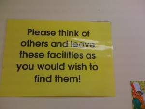 "Sign reading ""Please think of others and leave these facilities as you would wish to find them!"""