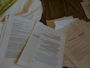 Several piles of printed paper