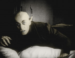 Nosferatu, all fangs and corpse-like pallor