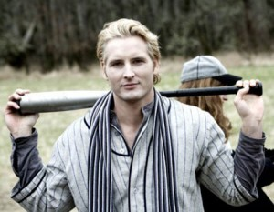 Carlisle Cullen from Twilight holds a baseball bat