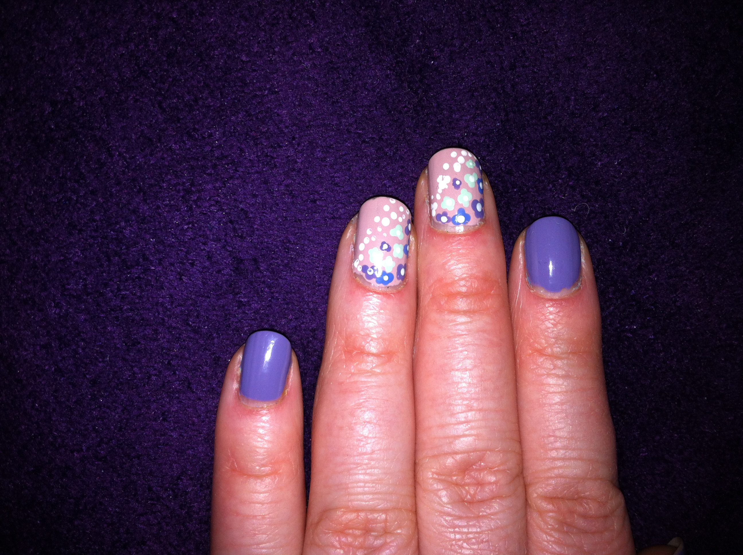 Violet nails with floral pattern on accent nails