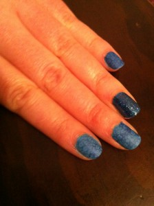 Blue manicure with stamped flower pattern