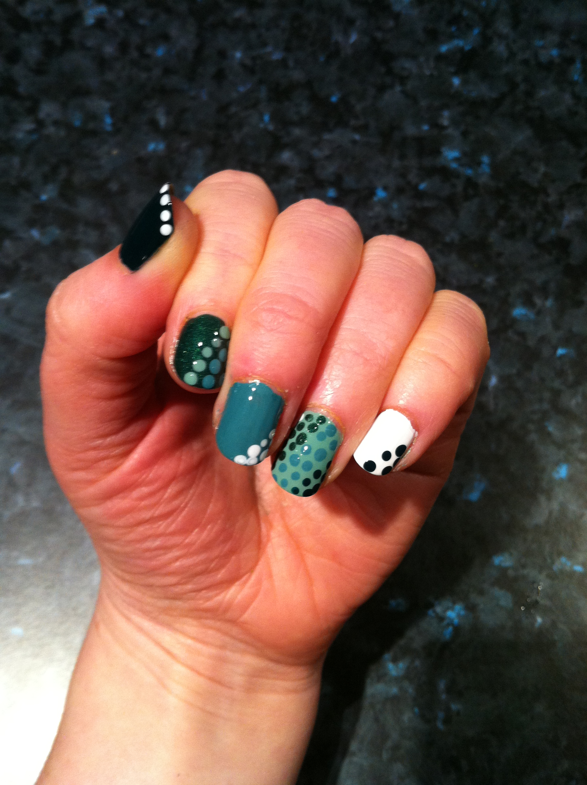 Green manicure with polka dots