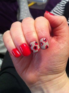 Red manicure with flowers
