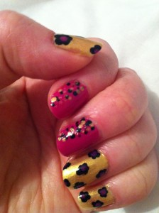gold nails with black flowers, pink accent nails with black and gold stippling