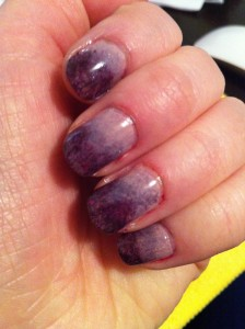 gradient nails going from light violet at base to deep purple glitter at tip