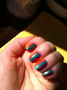 nails striped orange, pink, green, purple and violet